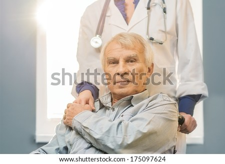 Nurse woman with senior man in wheelchair