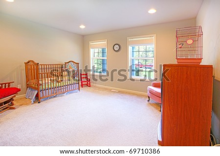 Nursery with cherry wood furniture - stock photo