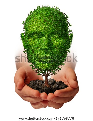 Nurture growth and ?life development concept with a hand holding a green tree shaped as a front view human head as a nature metaphor symbol for protection of the environment and growing potential. - stock photo