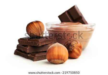 nut butter and chocolate with hazelnuts isolated on white - stock photo