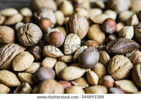 Nut mix on rustic wooden background
