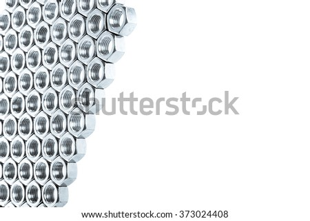 Nut screws tightly stacked next to each other on a flat surface. Nut background isolated on white.  - stock photo