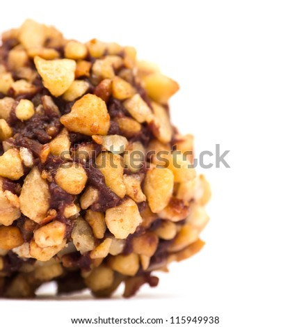 Nut truffle macro on white with copy space - stock photo