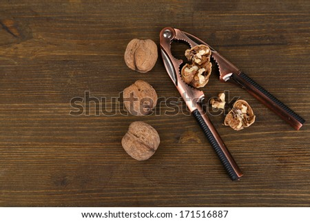 Nutcracker and walnuts isolated on white background