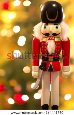 Nutcracker over Christmas bokeh background - stock photo