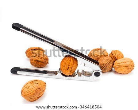 Nutcracker with walnuts cut out on white - stock photo