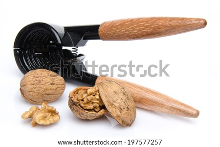 Nutcracker with walnuts, isolated on white