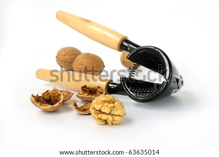 Nutmeat and nuts with nut cracker on white background