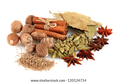 Nutmeg and other spices isolated on white - stock photo