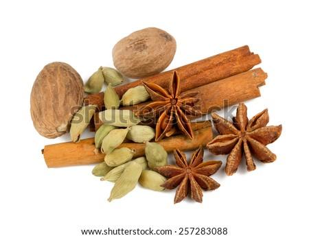 nutmeg, cinnamon, cardamom and star anise isolated on white - stock photo