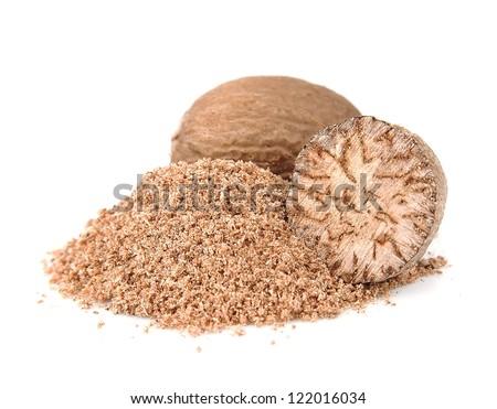 Nutmeg closeup on white. Nuts muscat. - stock photo