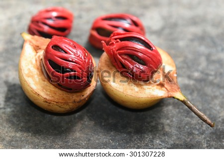 Nutmeg many isolated. Sectional view of ripe colorful red nutmeg fruit, seeds  Kerala India. spices known as pala in Indonesia and red mace from tree Myristica  Banda Islands Moluccas Spice Islands - stock photo