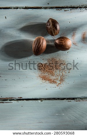 nutmeg on a wooden background - stock photo