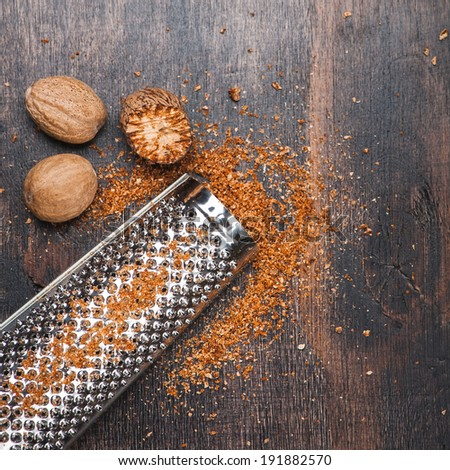 Nutmegs and grater for nuts  - stock photo