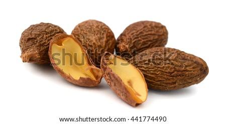Nutmegs macro isolated on white - stock photo