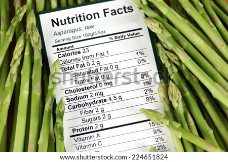 Nutrition facts of raw asparagus with asparagus background  - stock photo