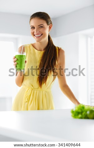 Nutrition. Healthy Eating Smiling Woman Holding Glass Of Fresh Raw Green Detox Vegetable Juice. Healthy Lifestyle, Vegetarian Diet And Meal. Drink Smoothie. - stock photo