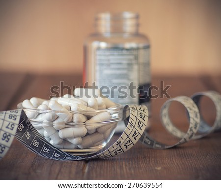 Nutritional supplements in capsules and tablets. - stock photo