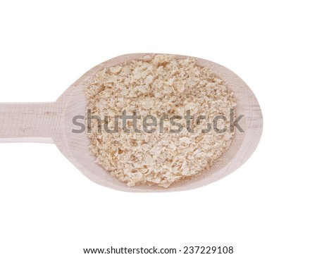 Nutritional yeast (deactivated yeast) in wooden spoon isolated on white background - stock photo