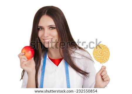 Nutritionist Holding an Apple and a Big Candy - Woman nutritionist comparing healthy and unhealthy dessert options, isolated on white background.   - stock photo