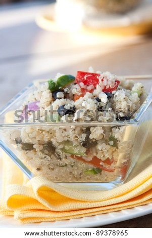 Nutritious and delicious salad made from Quinoa grains, feta cheese, olives, tomatoes, green peppers, celery, onions, and select spices - stock photo