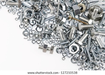 Nuts and bolts closeup on plain background - stock photo