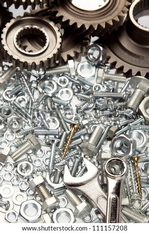Nuts, bolts, wrenches and cogs - stock photo