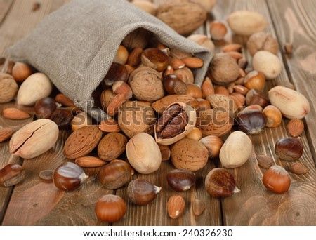Nuts in a bag on a brown background - stock photo