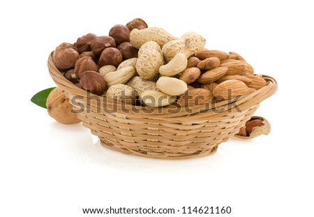 nuts in bowl isolated on white background