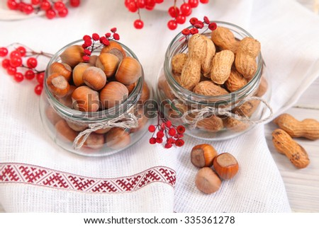 nuts in glass bowls - stock photo