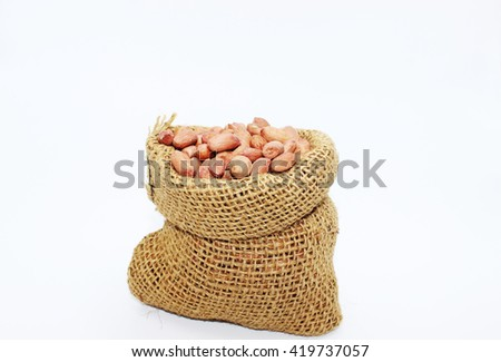 nuts in the sack cloth bag on white background