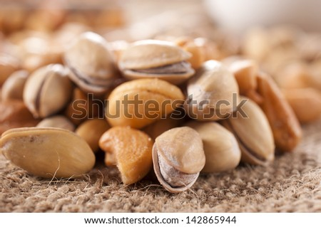 Nuts mix with pistachio and cashew nuts - stock photo
