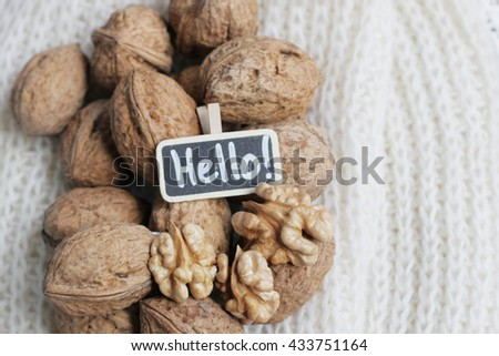 Nuts on knitted background. Nuts. Hazelnuts and walnuts. Shabby nut background. Many nuts. Many hazelnuts. Hazelnut background.  - stock photo