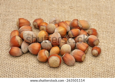 Nuts on old canvas - stock photo