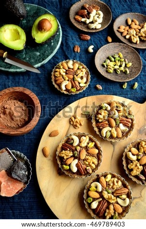 Nuts tarts with avocado on the cloth of deep blue.