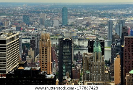 NY - AUG 1, 2013:  Panorama of the midtown East Side of Manhattan skyline,  the East River, and distant boro of Queens  * - stock photo