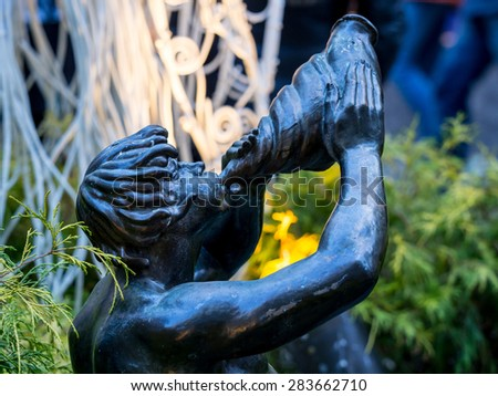 NY - Manhattan 31 dec 2014: Close up of unidentified sculpture in front Rockefeller center at christmas time in Manhattan. - stock photo