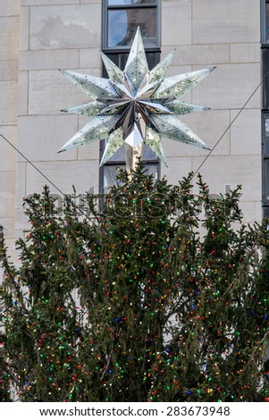 NY - Manhattan 31 dec 2014: svarowsky star on christmas tree in front Rockefeller building  in manhattan - stock photo