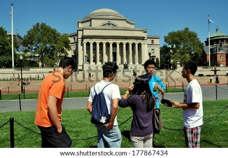 NY - SEPT 3, 2009:  Asian students get a campus briefing from an orientation leader (in blue tee-shirt) at Columbia University - stock photo