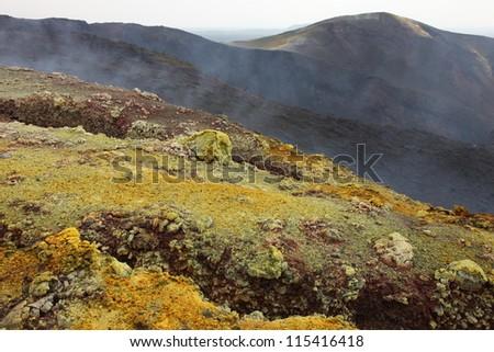 Nyamuragira (Nyamulagira) Volcano, Kimanura Eruption 2011-2012. Yellow sulfur deposits on craters formed during initial stage of eruption. - stock photo