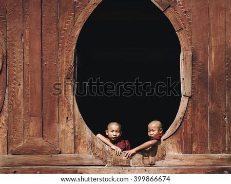 Nyaung Shwe, Myanmar - March 24: Novice Buddhist monks sitting by the window at Shwe Yan Pyay Monastery in Nyaung Shwe village, near Inle Lake, Shan State, Myanmar (Burma). - stock photo