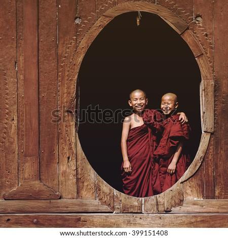 Nyaung Shwe, Myanmar - March 24: Novice Buddhist monks smiling at Shwe Yan Pyay Monastery in Nyaung Shwe village, near Inle Lake, Shan State, Myanmar (Burma).  - stock photo