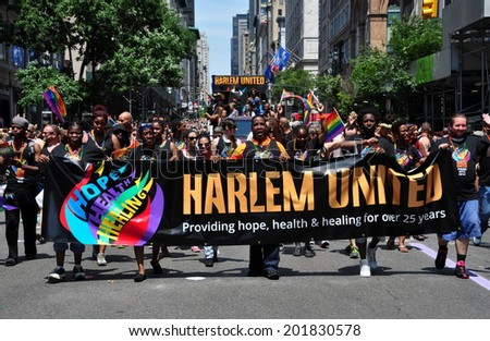 NYC - June 29, 2014:  Harlem United's large group marching at the 2014 Gay Pride Parade on Fifth Avenue - stock photo
