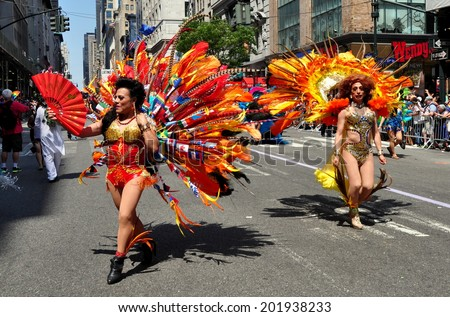 NYC - June 29, 2014:  Two members of the Latino Pride group sporting elaborate costumes marching in the 2014 Gay Pride Parade on Fifth Avenue