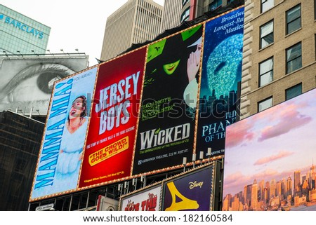 NYC, NEW YORK � CIRCA FEBRUARY 2014: Digital billboards showing advertisements for current theater plays in Times Square. - stock photo