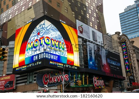 NYC, NEW YORK � CIRCA FEBRUARY 2014: Digital billboards showing advertisements for various products and television programs in Times Square. - stock photo