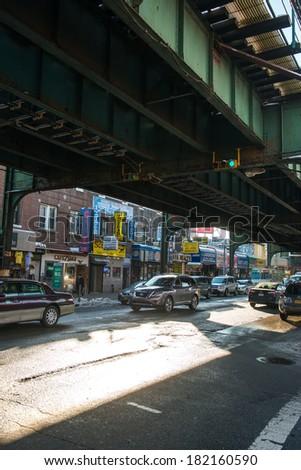 NYC, NEW YORK � CIRCA FEBRUARY 2014: Street traffic drives underneath a metro rail line on Roosevelt Street. - stock photo