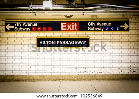 NYC Penn Station subway directional sign on tile wall