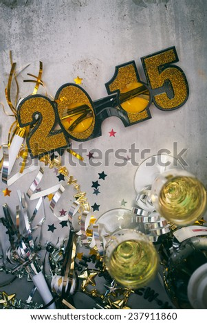 NYE Background: Glitter Glasses And Champagne to Celebrate New Year's - stock photo