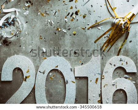 NYE: Glitter 2016 With Confetti And Party Horn - stock photo